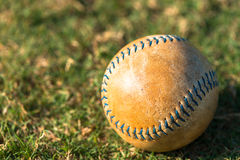 Softball Close Up on Field. Well Worn Softball Baseball Close Up on Field Stock Photography