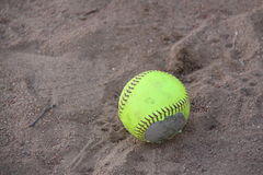 Softball in dirt Royalty Free Stock Photos