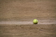 Softball in dirt. At a game girls Stock Image