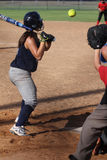 Softball. Game action batter waiting to hit a pitched ball Stock Photo