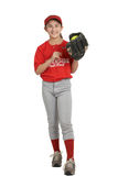 Softball girl. Smiling laughing preteen sports girl in softball uniform Royalty Free Stock Image
