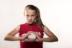 Softball Girl. Looking intense and challenging gripping ball Stock Photography