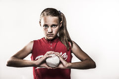 Softball Girl. Looking intense and challenging gripping ball retro look Royalty Free Stock Photos
