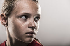Softball Girl. With sweat on her face staring intently Stock Images