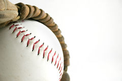 Softball and glove. Close up image of softball in glove Royalty Free Stock Photo