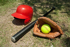Softball and glove. Softball with accessory bat, grove, ball Royalty Free Stock Photo