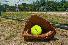 Softball and glove. Over Softball field Stock Photo