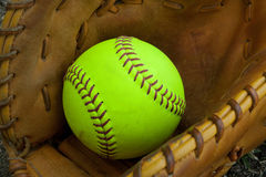 Softball and glove. Softball with accessory, grove, ball Stock Photos