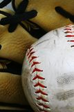 Softball and glove. A softball in a leather glove Stock Images
