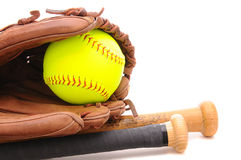Softball Glove ball and two bats on white. Closeup of a Softball Glove ball and two bats on white with copyspace. Horizontal format Royalty Free Stock Photography