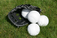 Softball glove and balls Royalty Free Stock Photos