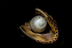 Softball and Glove in Sepia Royalty Free Stock Photos