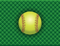 Softball on a Green Checkered Background Stock Image