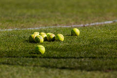Softball Group. Collection of softballs along foul line Royalty Free Stock Images