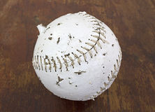 Softball that has been chewed on by dog Royalty Free Stock Image