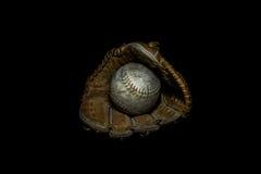 Softball i rękawiczka w Sepiowym fotografia stock