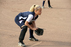 Softball infielder. Blonde young girl playing infield for her softball team Stock Photography