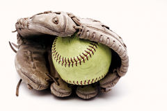 Softball inside of old leather glove stock photo