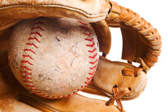 Softball in mitt isolated Stock Images