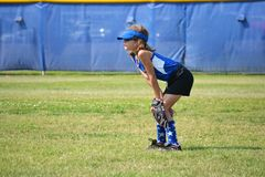 Softball Player Ready for the Next Play. Softball Player in the outfield Ready for the Next Play Royalty Free Stock Image