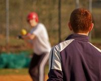 Softball / Practice. Coach and young player, practice Royalty Free Stock Image
