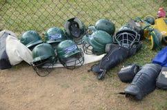 Softball equipment protective helmet and catcher`s knee guarda stock photo