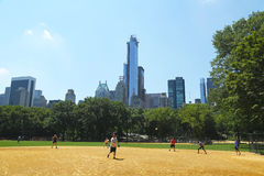 Softball teams playing at Heckscher Ballfields in Central Park Stock Photos