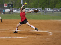 Softball windmill. A fastpitch softball player pitching the windmill Royalty Free Stock Image