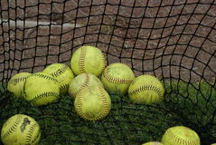 Softballs in batting net Stock Photos