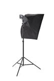 A softbox isolated on a white background. Professional lighting equipment. A stripbox with a flashlight. Photographic tools. Royalty Free Stock Images