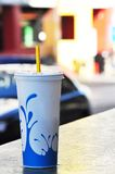 Softdrink disposable cup on street. White soft drink cup on a street bench Stock Image