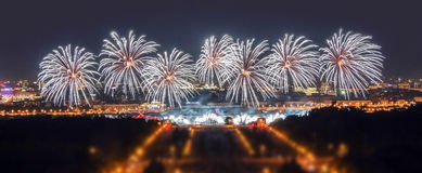 Soften edge view of Moscow firework festival in the Lenin Hills area with thousands of smart phone flashes and water reflections Royalty Free Stock Photo