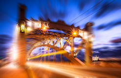 Soften edge view of white night car traffic through the famous Saint Petersburg bridge named after Peter the Great Royalty Free Stock Photos