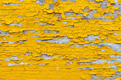 Softened plank wall with bright yellow paint Stock Photo