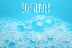 Softener concept. Soap suds foam and bubbles from detergent.  stock photography