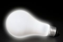 Softly glowing light bulb Stock Photo