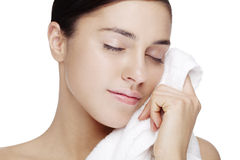 Softness. Sfresh faced female with clean white towel. skin has been retouched to keep all texture Stock Photography