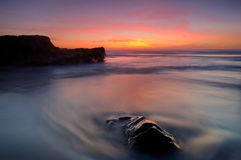 Softness in the tide. Magoito beach, board of Sintra, Portugal Royalty Free Stock Photos