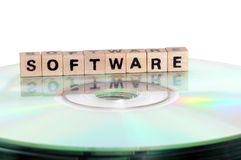 Software. The word Software written in wooden letters standing on a computer-CD Royalty Free Stock Images