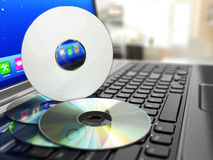 Software CD on laptop keyboard. Compact disks. Stock Photography