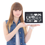 Software concept - cute teenage girl holding laptop with multime. Dia applications icons isolated on white background Stock Photo