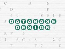 Software concept: Database Design on wall background. Software concept: Painted green text Database Design on White Brick wall background with Hexadecimal Code Stock Photos