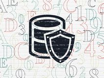 Software concept: Database With Shield on wall background Royalty Free Stock Images