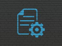 Software concept: Gear on wall background. Software concept: Painted blue Gear icon on Black Brick wall background Stock Photo