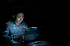 Software developer. Coding on his laptop at night Stock Images