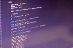 Software developer programming code. On a monitor royalty free stock image