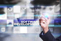 Software development on virtual screen. Applications for business. Programming. Stock Photo