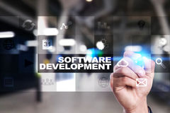Software development on virtual screen. Applications for business. Programming. Software development on virtual screen. Applications for business. Programming Stock Photos