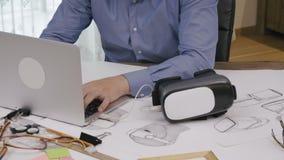 Software engineer programming VR headset