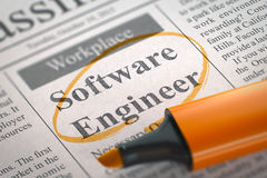Software Engineer Wanted. 3D. A Newspaper Column in the Classifieds with the Jobs Section Vacancy of Software Engineer, Circled with a Orange Marker. Blurred stock photography